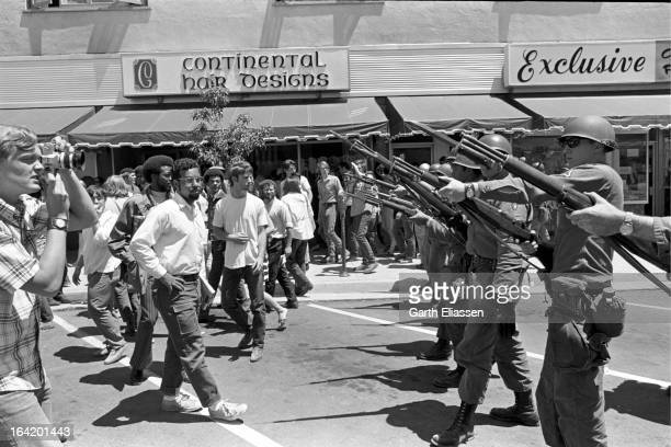 California National Guardsmen, bayonets at the ready, block the street during protests near People's Park on the campus of the University of...