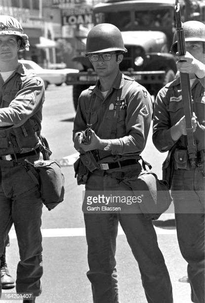 California National Guardsmen bayonets at the ready stand on guard during protests near People's Park on the campus of the University of Berkeley...