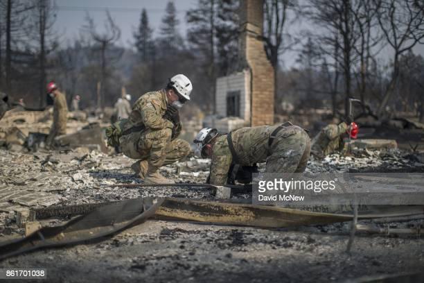 California National Guardsmen find bones at a fire-devastated home near Mark West Springs Road and Old Redwood Highway on October 15, 2017 in Santa...
