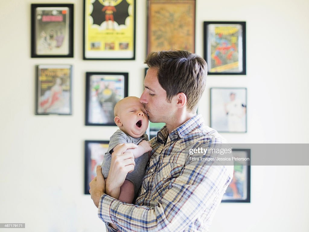 USA, California, Orange County, Father kissing baby son (2-5 months) : Stock Photo