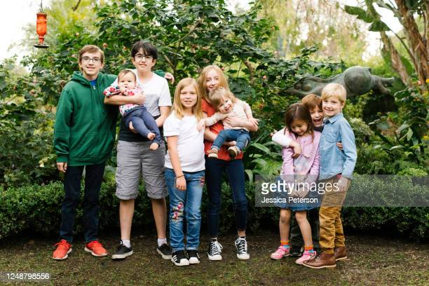 usa, california, orange county, group of children (12-17 months, 2-3, 6-7, 10-11, 12-13, 14-15) posing in garden - 12 17 months stock pictures, royalty-free photos & images