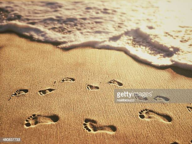 USA, California, Orange, Laguna Beach, Footprints on sand