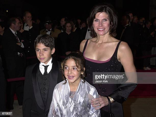 California Rep Mary Bono her daughter Chianna and her son Chesare arrive at the Palm Springs International Film Festival gala January 13 2001 in Palm...