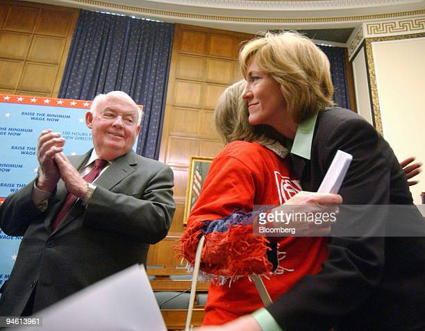 California Representative Betty Sutton right hugs Gina Walters center a 44yearold mother from Ohio who works for minimum wage as a cashier at a...