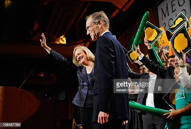 California Republican gubernatorial candidate and former eBay CEO Meg Whitman waves at supporters with her husband Dr Griff Harsh at her side after...