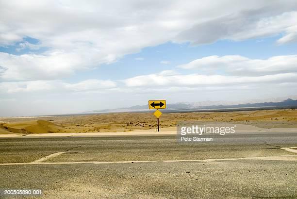 USA, California, road crossing in Glamis Dunes