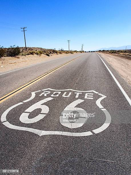 USA, California, Route 66 with sign on road, desert
