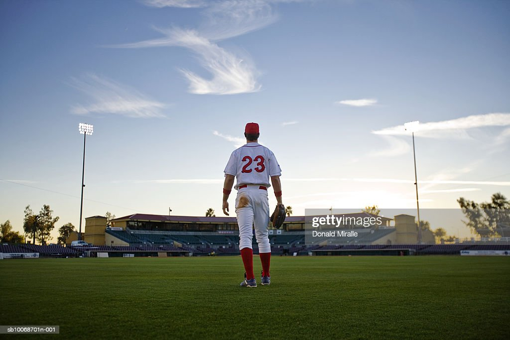 USA, California, San Bernardino, baseball outfielder looking towards diamond : Stock Photo
