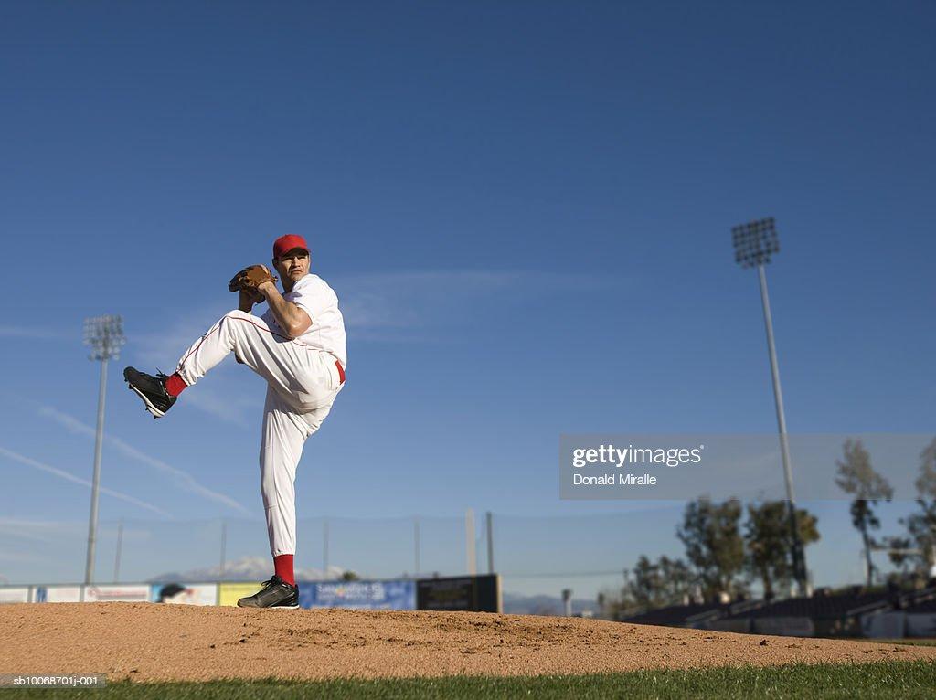 USA, California, San Bernardino, baseball pitcher throwing pitch, outdoors : Stock Photo