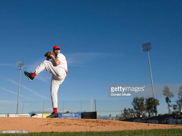 USA, California, San Bernardino, baseball pitcher throwing pitch, outdoors