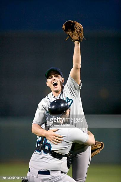 usa, california, san bernardino, baseball players celebrating victory - baseball player stock pictures, royalty-free photos & images