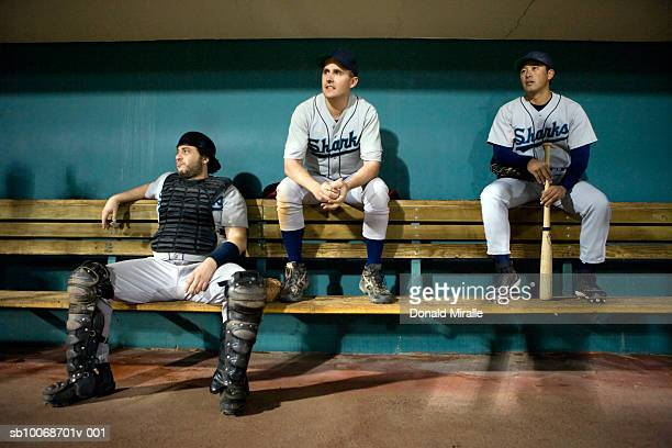 usa, california, san bernardino, baseball players sitting in dugout - baseball player stock pictures, royalty-free photos & images