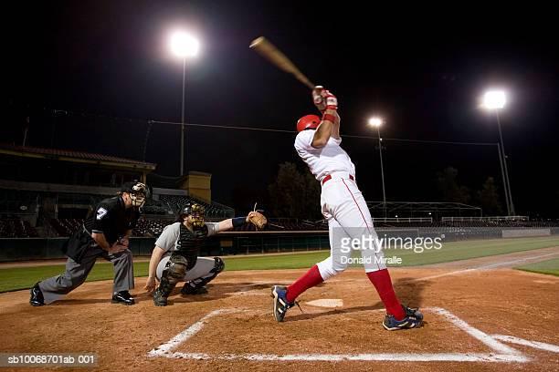usa, california, san bernardino, baseball players with batter swinging - batting stock pictures, royalty-free photos & images