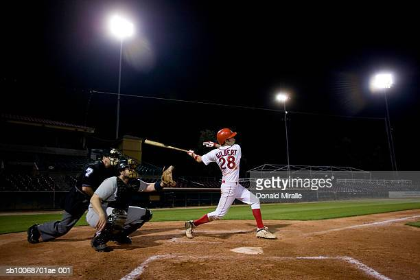 usa, california, san bernardino, baseball players with batter swinging - swinging stock pictures, royalty-free photos & images