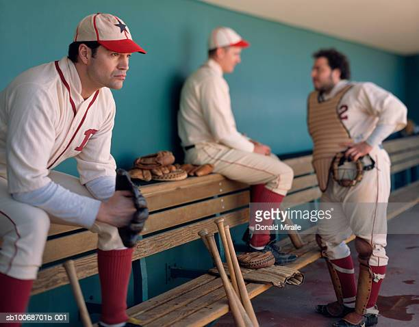 USA, California, San Bernardino, retro-style baseball players in dugout