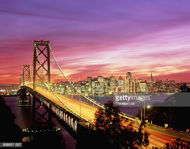 USA, California, San Francisco, Bay Bridge and city skyline at sunset