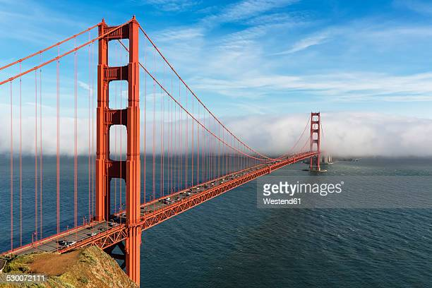 USA, California, San Francisco, Golden Gate Bridge seen from Hawk Hill with fog hiding city