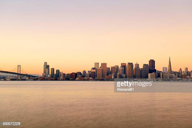 usa, california, san francisco, oakland bay bridge and skyline of financial district in morning light - oakland bay bridge stock pictures, royalty-free photos & images