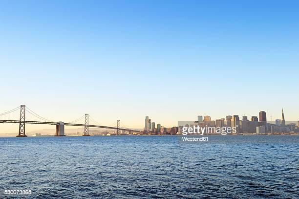 USA, California, San Francisco, Oakland Bay Bridge and skyline of Financial District in morning light