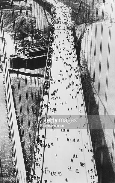 USA California San Francisco Opening of the Golden Gate Bridge view from a pillar of pedestrians on the bridge June 1937 Vintage property of ullstein...