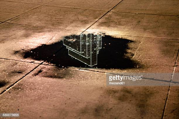 USA, California, San Francisco, reflection of a skyscraper in a puddle at night