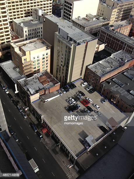 USA, California, San Francisco, Rooftop car park and city buildings