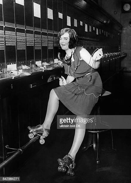 USA California San Francisco Women at work A switchboard operator on roller skates on night shift in the telecommunications office of San Francisco...