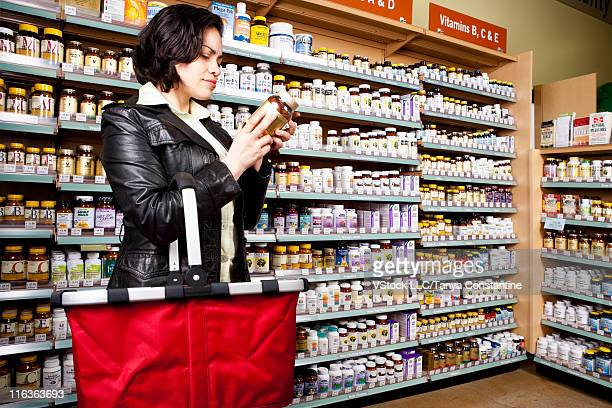 USA, California, San Rafael, Woman shopping in drug store