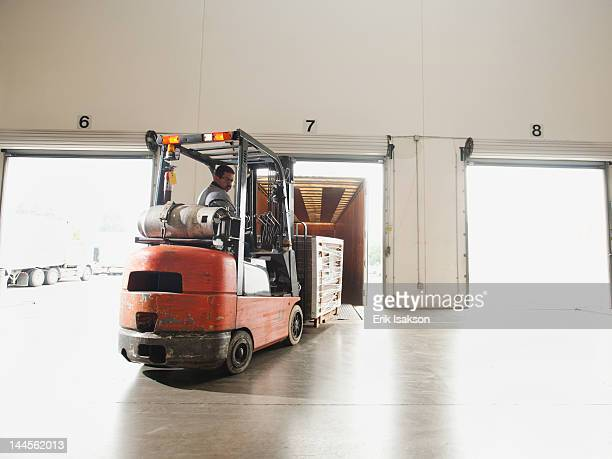 USA, California, Santa Ana, Forklift driver working in warehouse