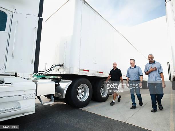 usa, california, santa ana, three men walking between  trucks - santa ana california stock pictures, royalty-free photos & images