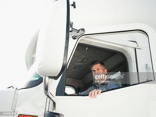 USA, California, Santa Ana, Truck driver entering truck