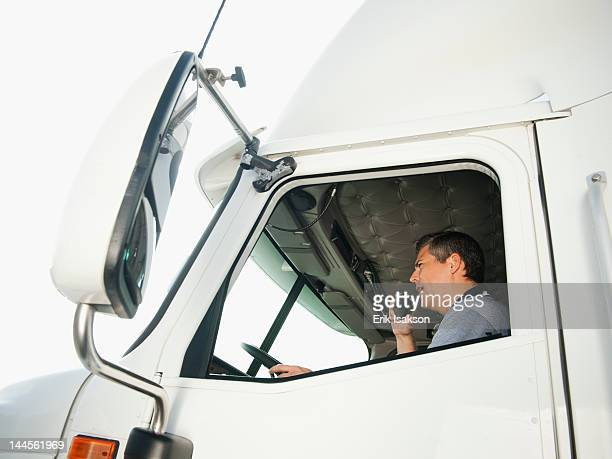 usa, california, santa ana, truck driver sitting in truck and talking on cb radio - santa ana california stock pictures, royalty-free photos & images