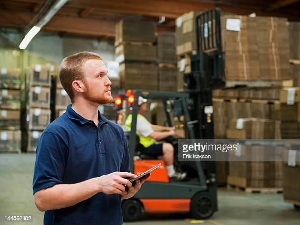 usa, california, santa ana, warehouse worker - santa ana california stock pictures, royalty-free photos & images