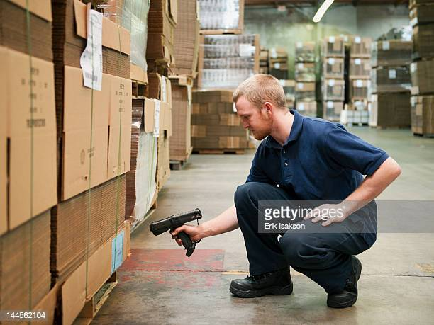 USA, California, Santa Ana, Warehouse worker scanning delivery