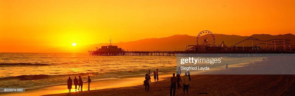 USA, California, Santa Monica Pier and beach at sunset : Stock Photo