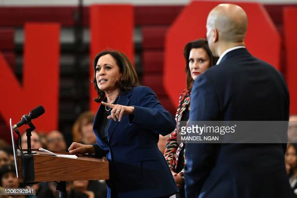 California Senator Kamala Harris speaks as New Jersey Senator Cory Booker and Michigan Governor Gretchen Whitmer listen during a Democratic...
