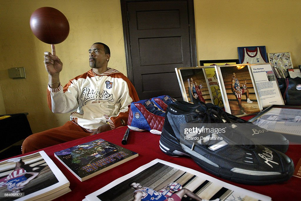California Sneakers Mobile Museum featuring former Harlem Globetrotter Milton Banks, spinning a bas : News Photo