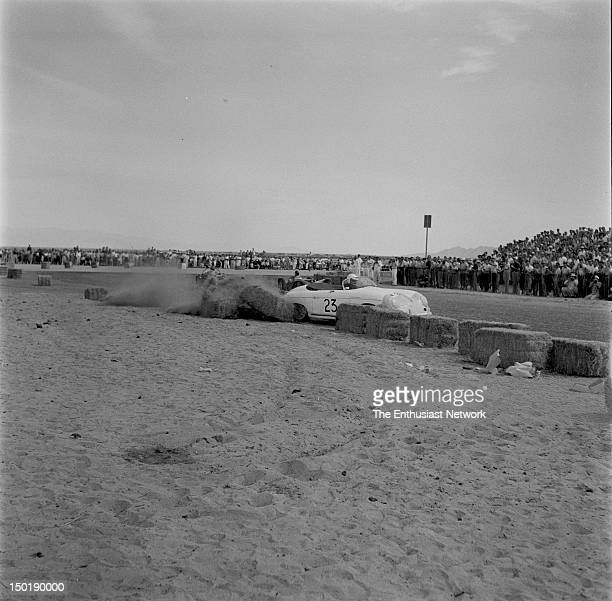 California Sports Car Club presents the 8th Palm Springs Road Race March 2627 1955 Actor James Dean tangles with the hay bales in turn while racing...