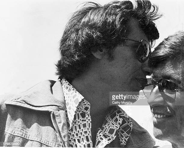 California State Assemblyman Richard Alattore whispers in the ear of labor activist and United Farm Workers cofounder Cesar Chavez California 1975 or...