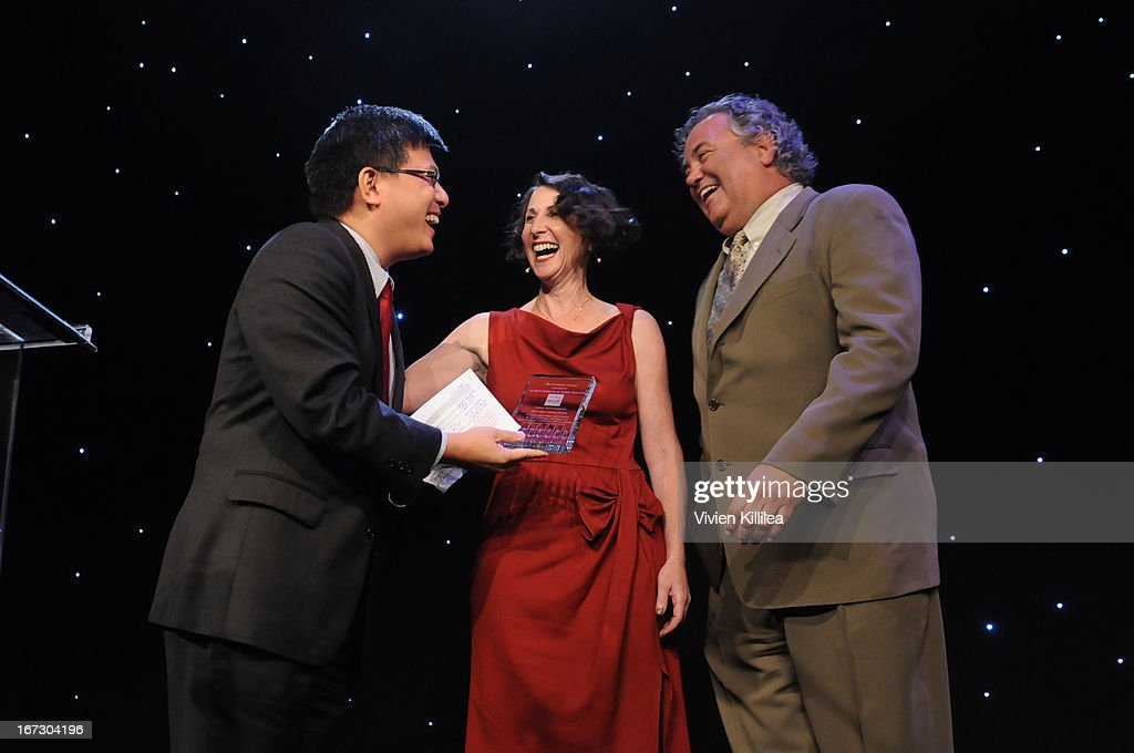 California State Controller John Chiang presents the Founders Award to Alison Morgan and Parke Skelton during Liberty Hill's Upton Sinclair Awards Dinner Honors - Show at The Beverly Hilton Hotel on April 23, 2013 in Beverly Hills, California.