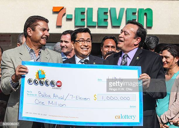 California State Lottery spokesperson Russ Lopez, center, looks on as Balbir Atwal, left, owner of the California 7-Eleven that sold one of the 3...