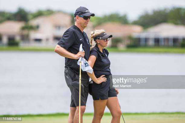 California State San Marcos Coach Greg Hutton consoles Breann Horn as their dreams of victory fade away during the Division II Women's Golf...