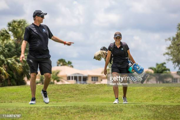 California State San Marcos coach Greg Hutton shares a laugh with Senior Bergen Benedict during the final holes of golf during her college career The...