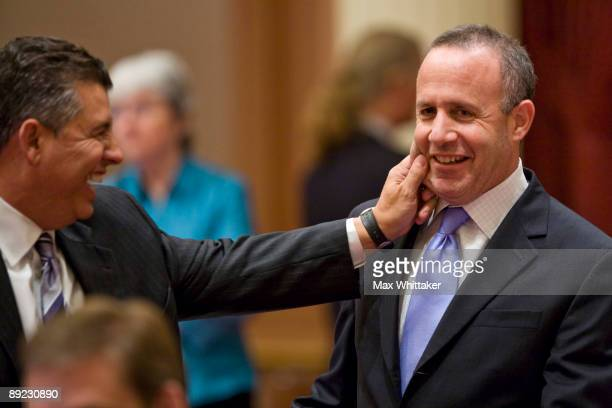 California State Sen Abel Maldonado pinches the cheek of Senate President Pro Tem Sen Darrell Steinberg during the vote on a solution to the state's...
