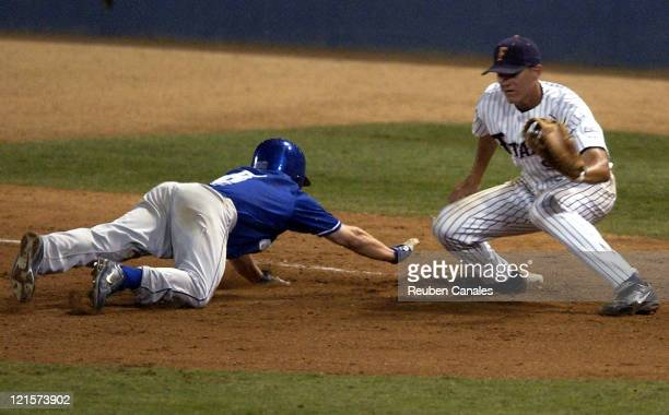 California State UniversityFullerton Titans infielder Brett Pill covers first base as they deafeated the Saint Louis University Billikens 6 to 1 in...