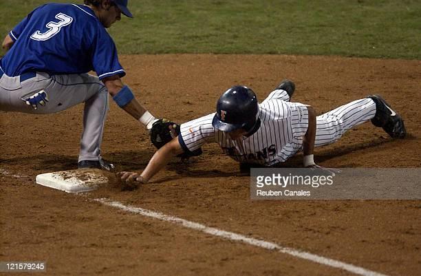 California State UniversityFullerton Titans infielder Brett Pill dives back into first base as they deafeated the Saint Louis University Billikens 6...