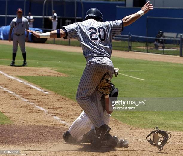 California State UniversityFullerton Titans outfielder Brandon Tripp scores a run as they deafeated the Long Beach State Dirtbags 2 to 10 on May 28...