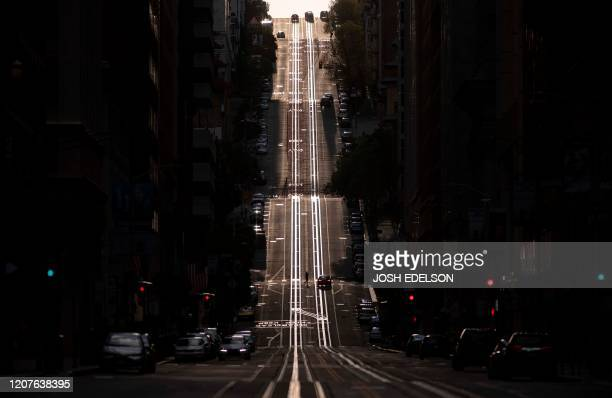 California Street, usually filled with cable cars, is seen empty in San Francisco, California on March 18, 2020. - San Francisco, along with seven...