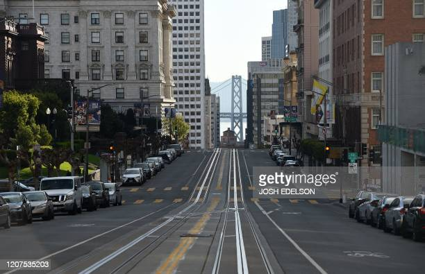 California Street usually filled with iconic cable cars is seen mostly empty in San Francisco California on March 17 2020 Millions of San Francisco...
