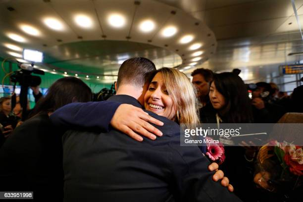 California student Sara Yarjani right receives a hug from a friend after arriving at the Tom Bradley International Terminal at LAX on February 5 2017...